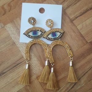 Large statement evil eye gold tone fringe earrings
